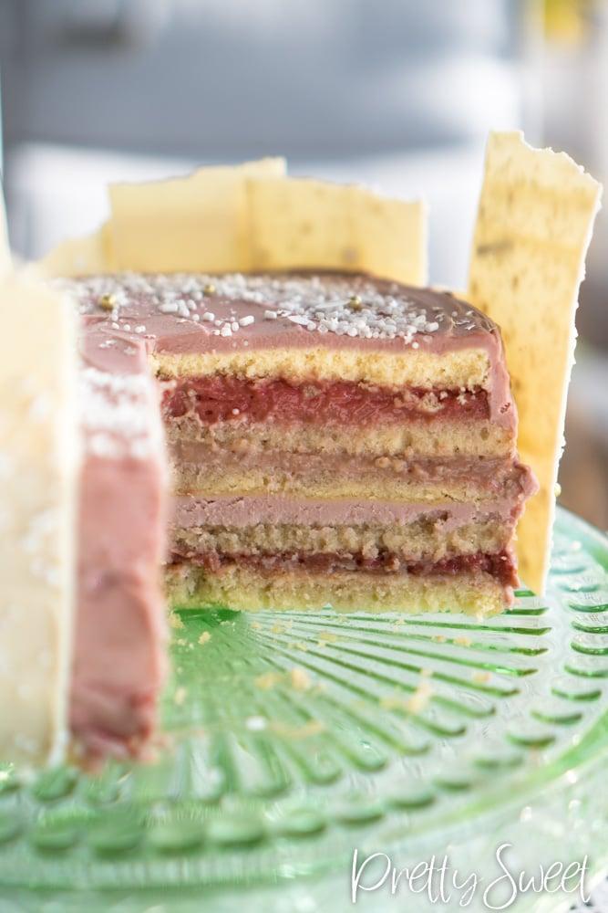 Champagne cake with vanilla sponge, pomegranate cream, and ruby chocolate ganache