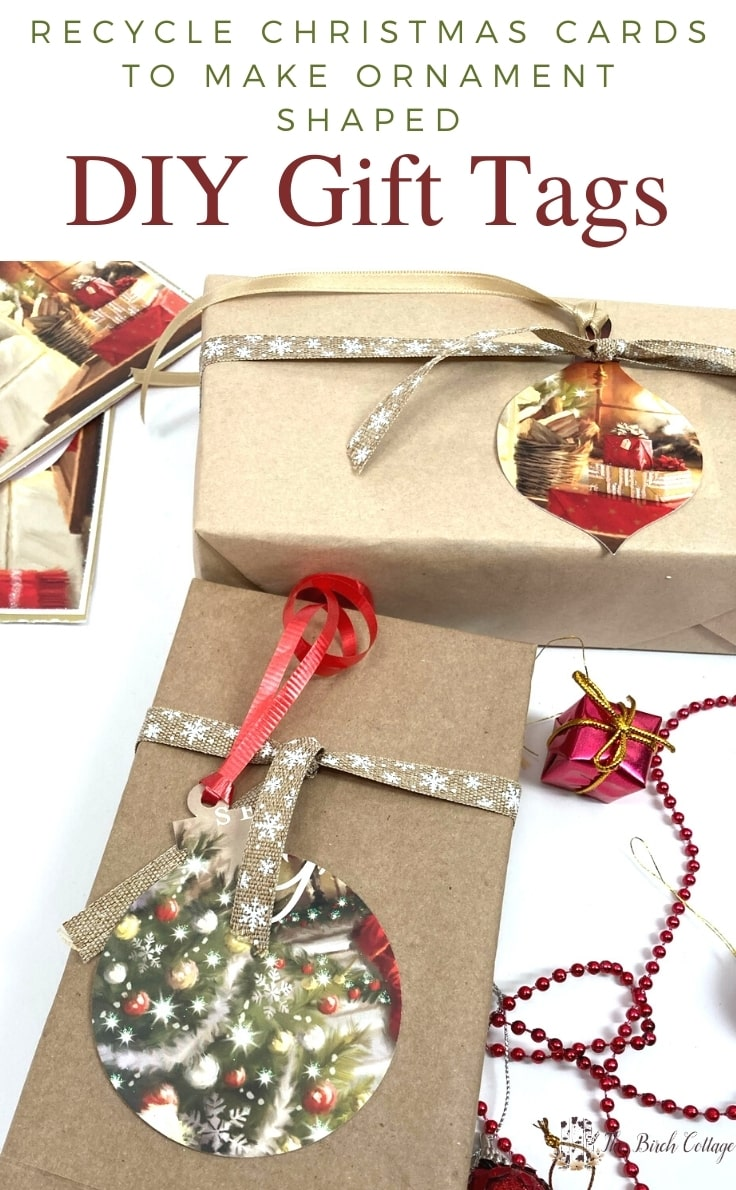 Wrapped Christmas presents with ornament-shaped gift tags made from recycled Christmas cards.