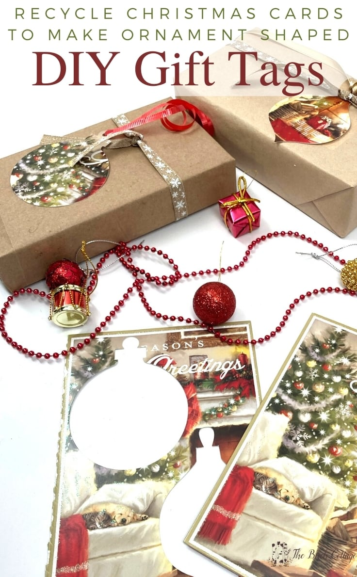 Christmas cards with ornament-shaped cutouts used as gift tags on wrapped presents