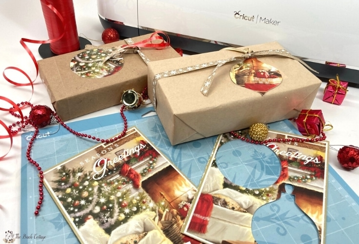 2 boxes wrapped in brown paper with Christmas card gift tags tied on with ribbon