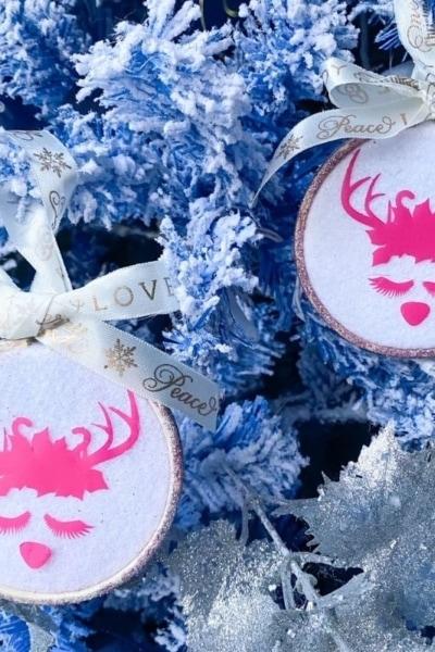 set of 2 Christmas ornaments on blue tree