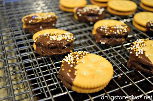 Chocolate-dipped Rolo-stuffed crackers with gold and white sprinkles