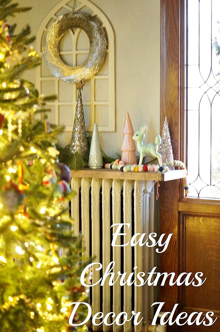 Christmas decorations on a mantle including trees, garland, and a wreath with text overlay
