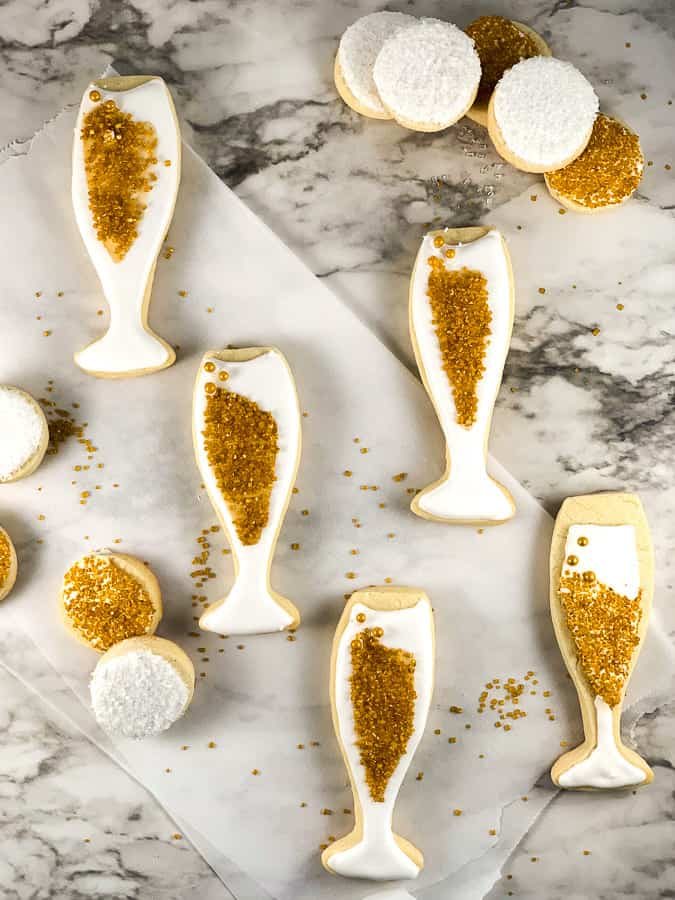 Champagne flute shaped sugar cookies with gold sprinkles