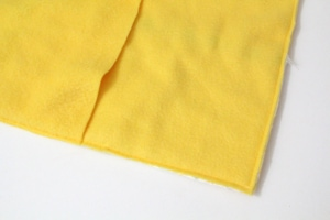 two pieces of yellow fleece fabric overlapping in the center