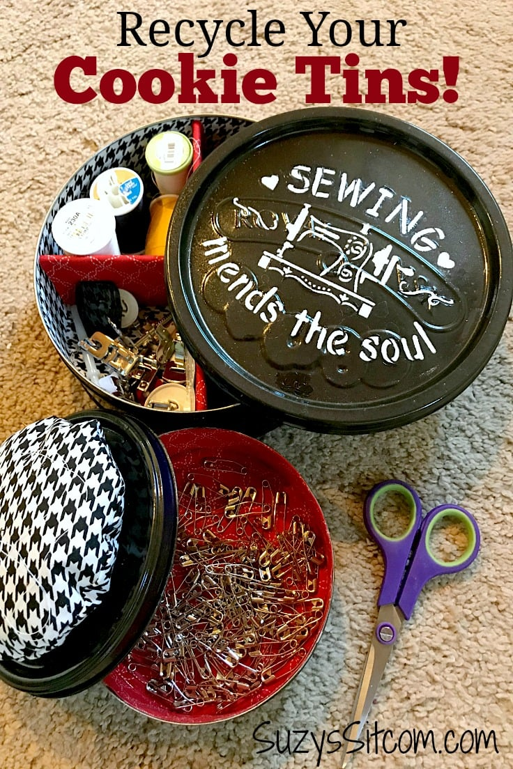 metal cookie tin repurposed as a sewing kit with paint and fabric