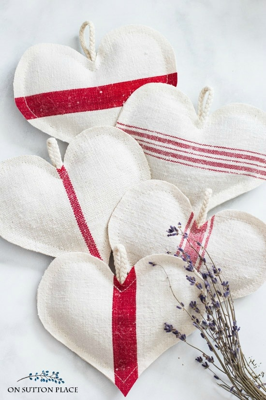 5 heart sachets made out of white grain sacks from On Sutton Place.