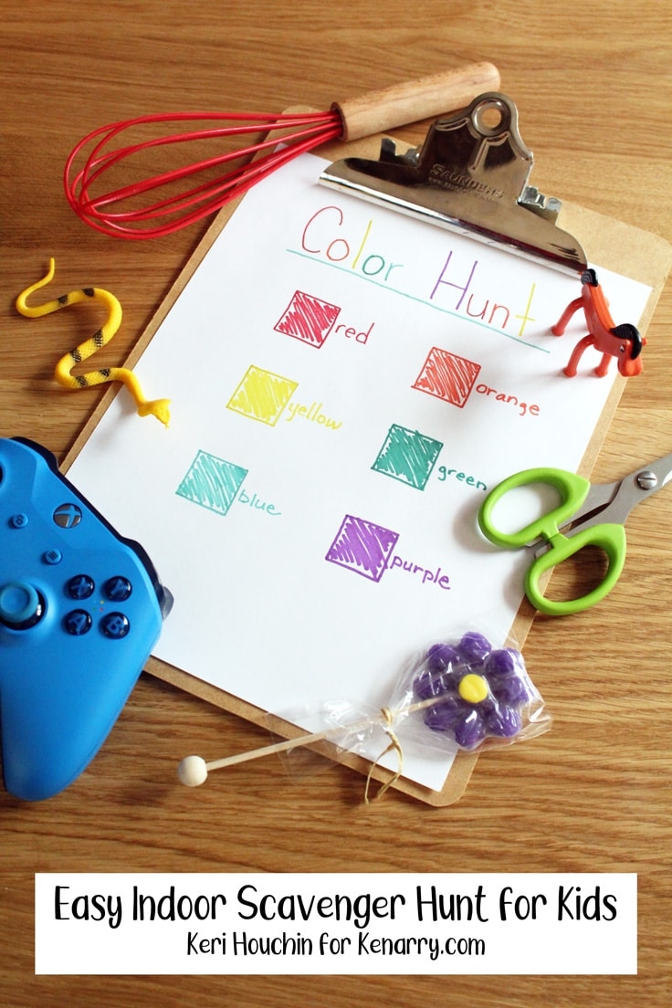 Color themed scavenger hunt boxes on a clipboard with matching household items scattered around.
