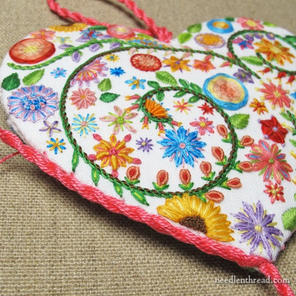 Detailed hand embroidery flower patterned heart sachets from Needle 'n Thread.