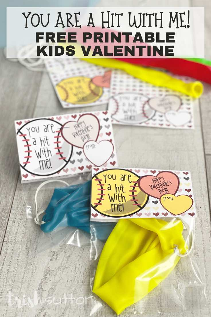 Kids Valentine on a wood background; includes punch balloons and note cards.