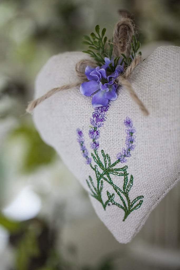 A brown heart sachet with a lavender flower embroidered on it from Celebrate Creativity.