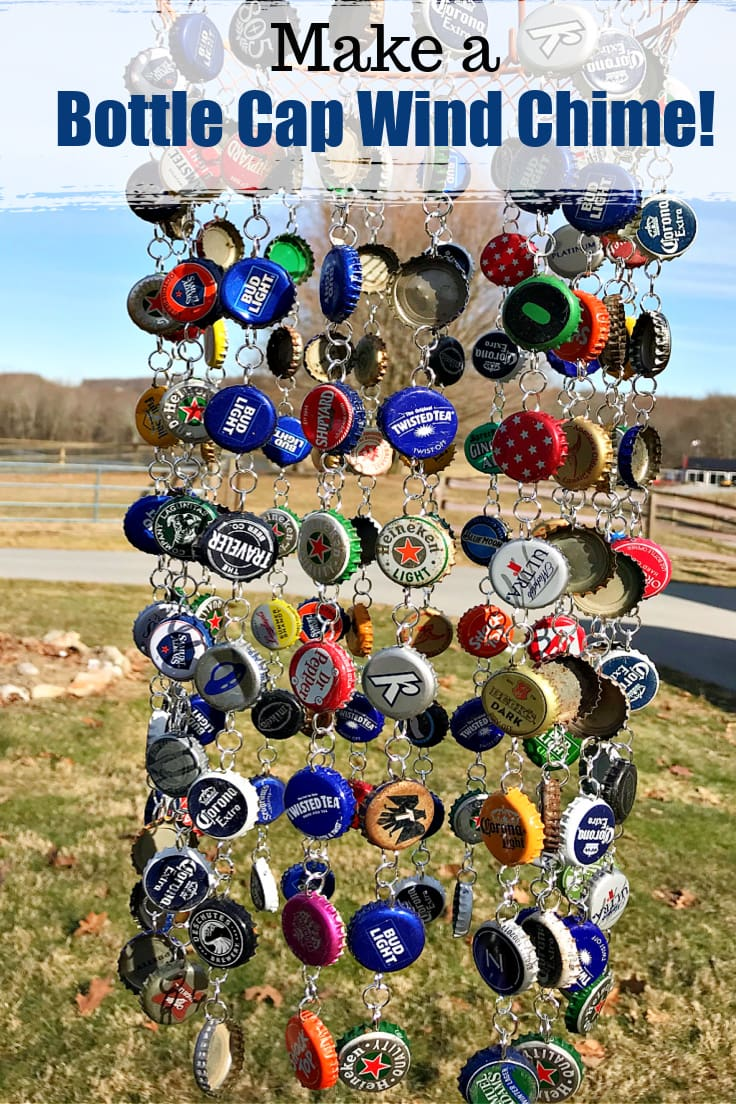 A DIY bottle cap wind chime hanging outdoors.