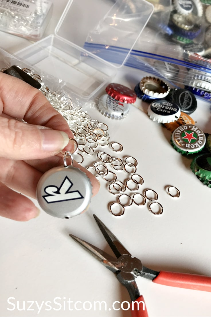 Adding jump rings to the bottle cap edges.