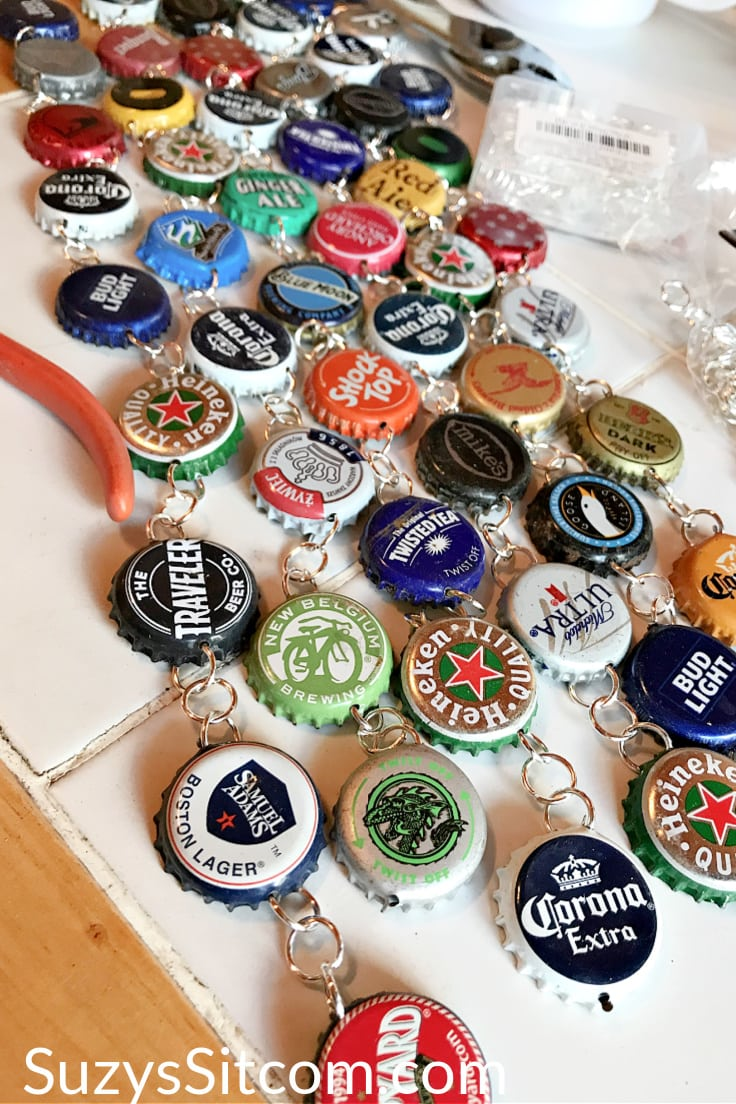 Connecting bottle caps together at the jump rings for a wind chime.