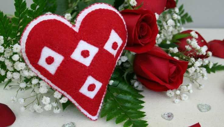 A red heart sachet with 4 white diamond shapes on it from Supermom No Cape.