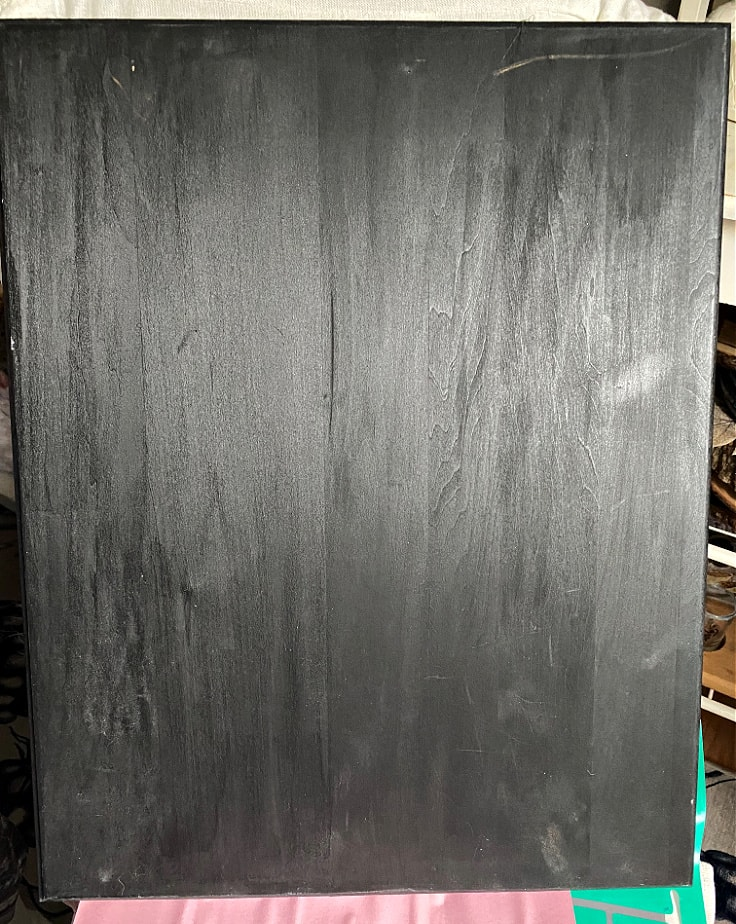 black chalkboard sign with clear wax