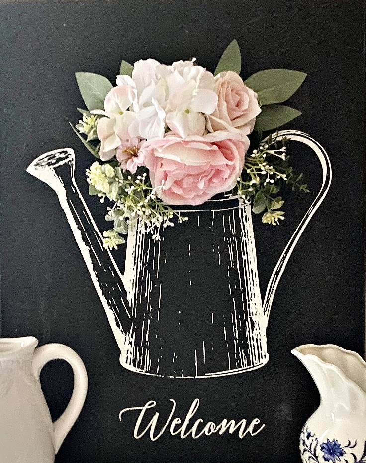 chalkboard watering can sign that reads