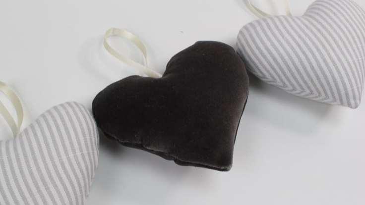 DIY heart sachets in alternating dark velvet and gray pinstripe material from Made to sew.