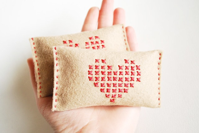 2 rectangle hand warmers with cross-stitched hearts from Wild Olive.
