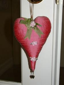 A red potpourri-filled sachet hanging on a doorknob from Matt and Shari
