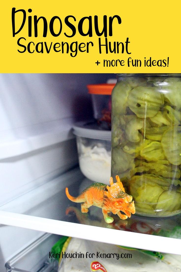 Small plastic dinosaur inside a refrigerator beside a jar of pickles.