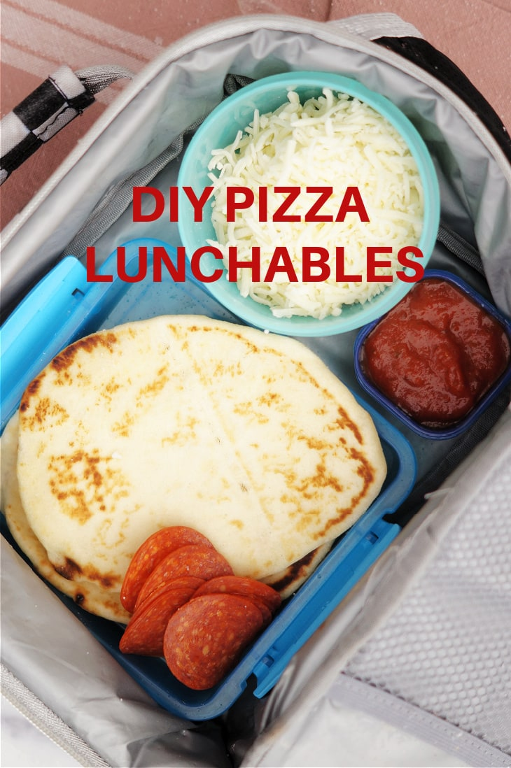 DIY Pizza Lunchables in a plastic container for a child's lunch box.