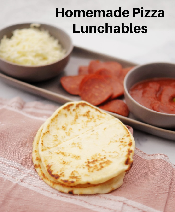 Homemade Pizza Lunchables ingredients including crust, cheese, pepperoni, and sauce.