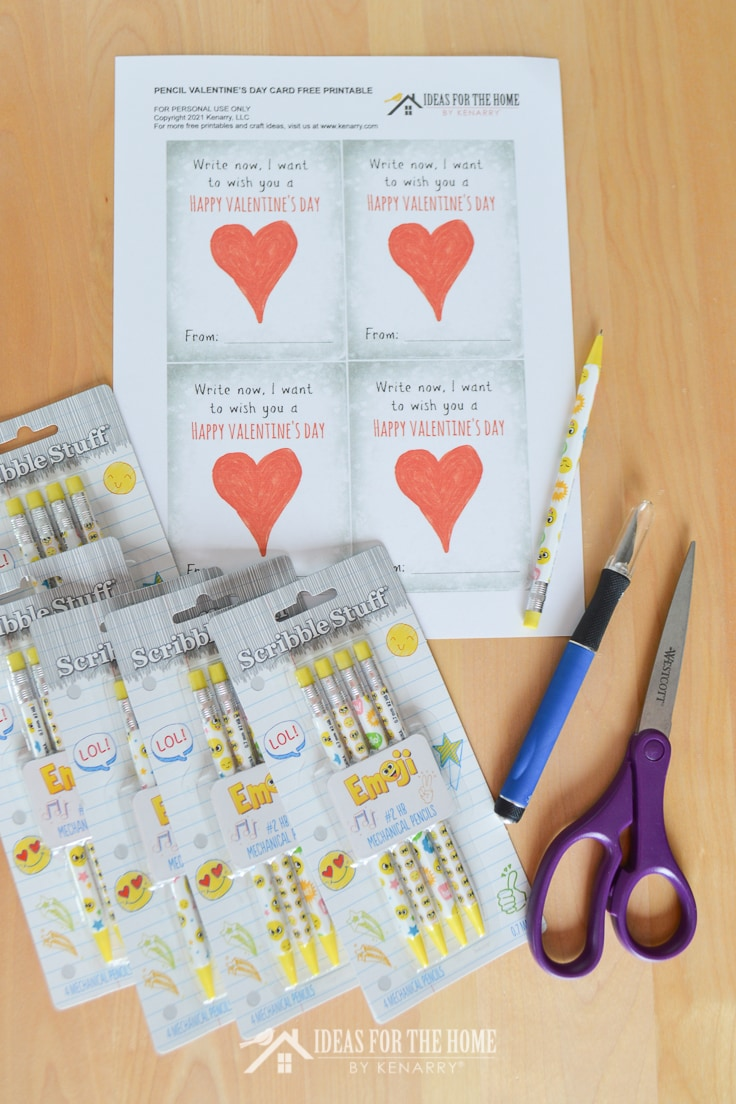 Pencils, scissors and xact-o knife to make Valentine's Day cards.