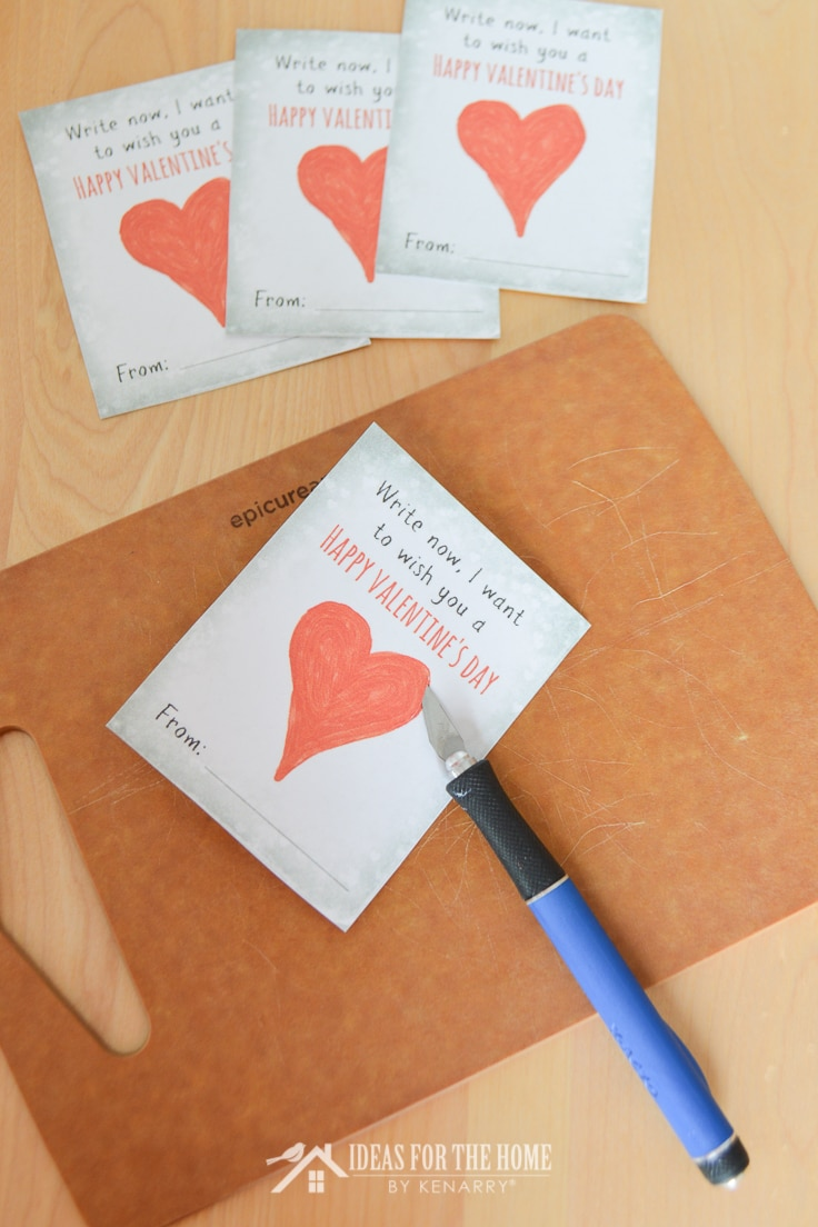 Xacto knife to cut slit to insert pencil through Valentine's Day cards.