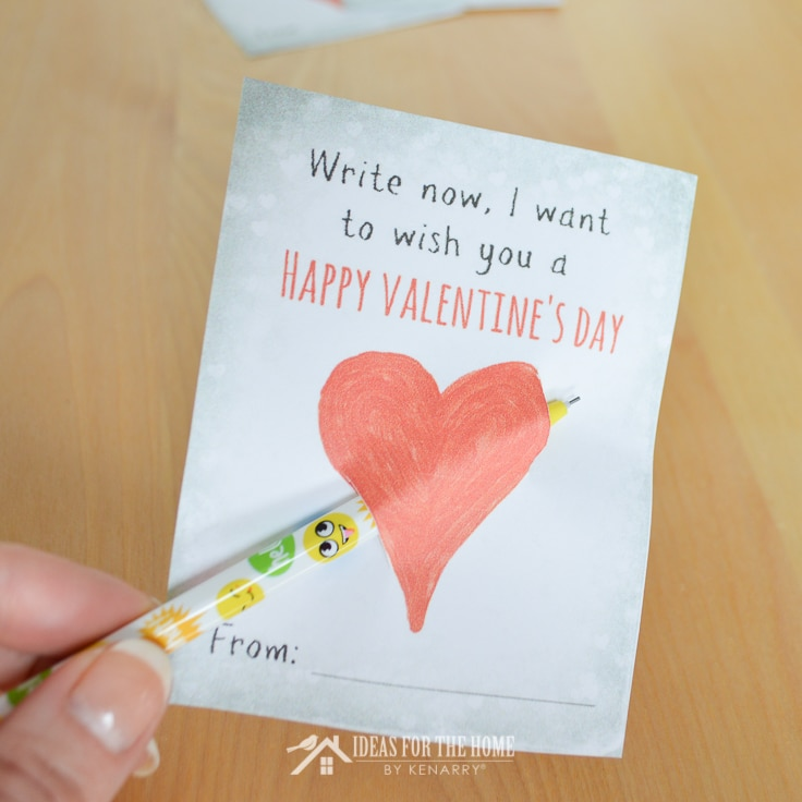 Inserting a mechanical pencil through a kids Valentine's Day card.