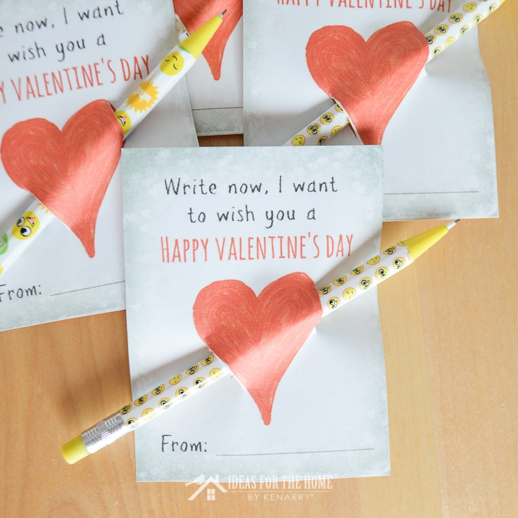 Pencils inserted through free printable cards that say