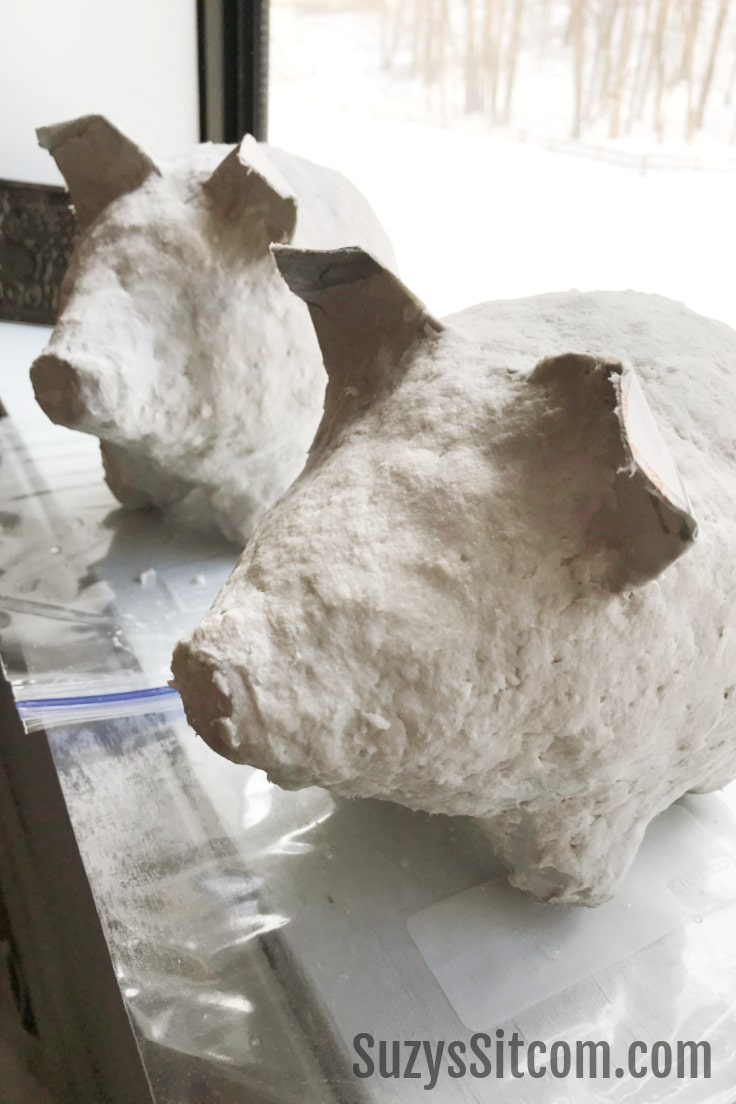 Pig shapes coated in instant paper mache material.