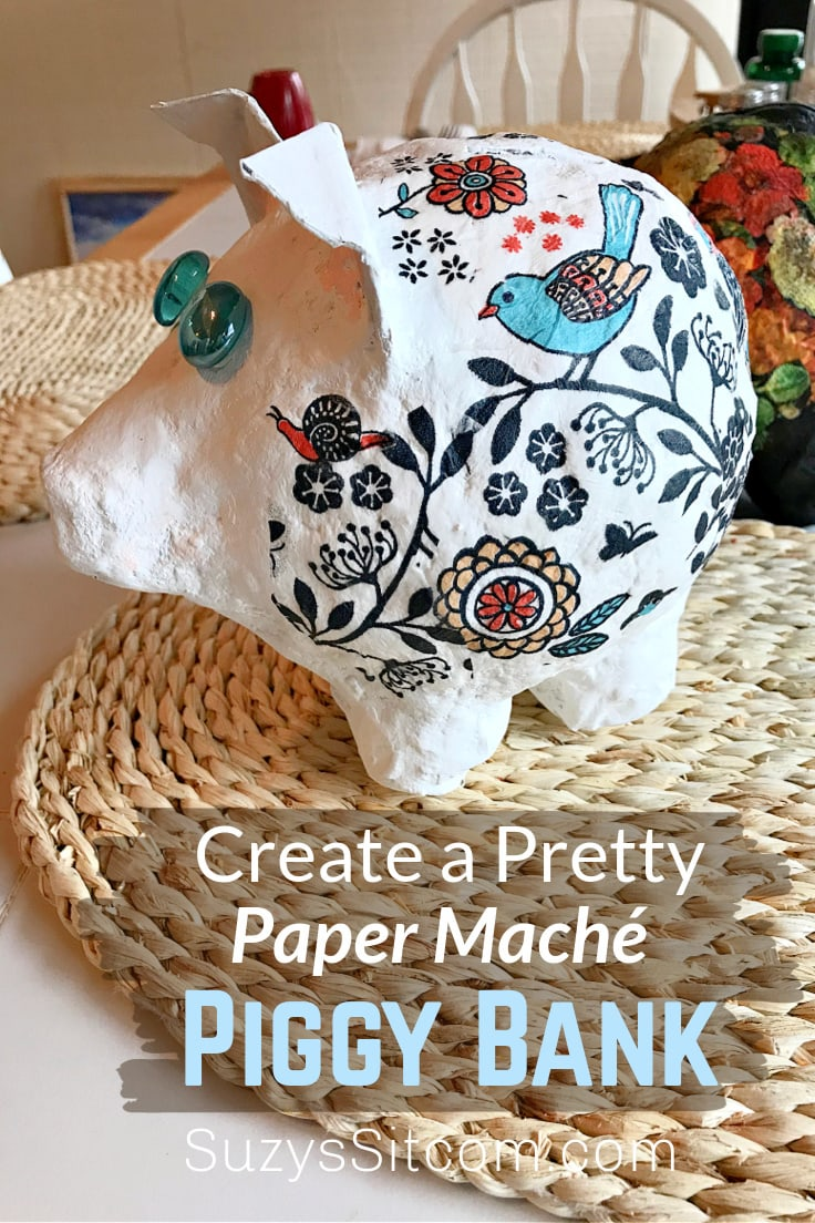 Paper mache piggy bank made with decoupage and patterned napkins.