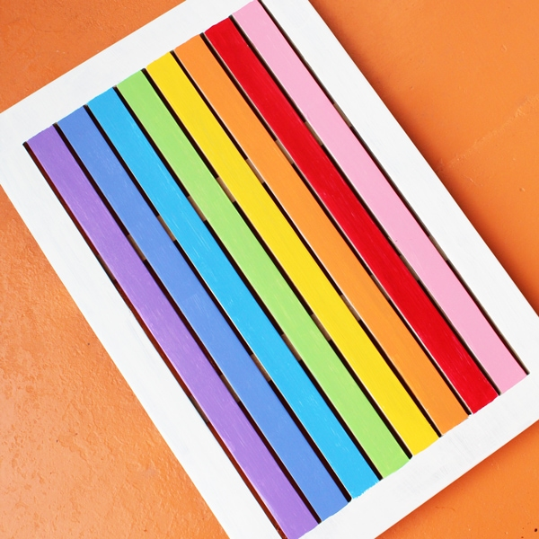 DIY rainbow welcome mat from One Mama's Daily Drama.