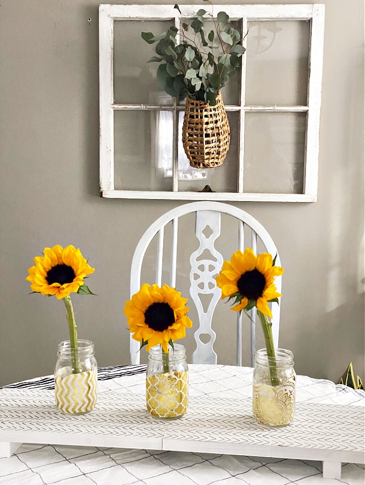 Set of 3 mason jar flower vases on table.