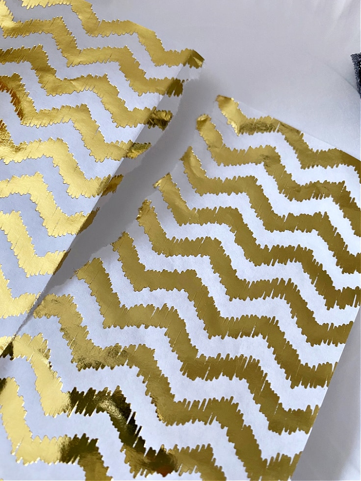 Decoupage sheet in gold and white stripes.