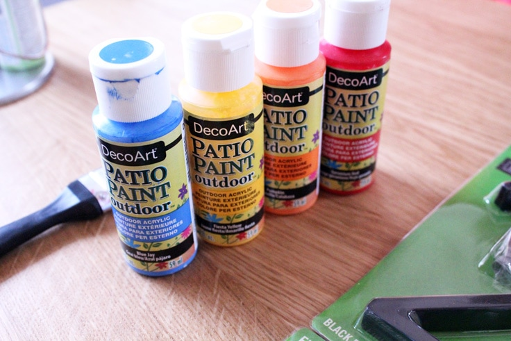 Decor Art patio paint bottles in blue, yellow, orange, and red.