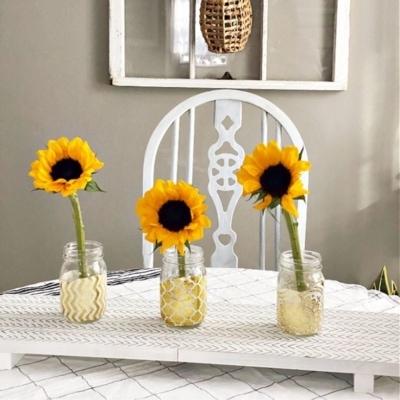 boho flower mason jars on table
