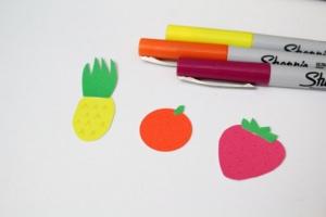 Paper pineapple, orange, and strawberry.