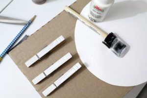 Painting clothespin white.
