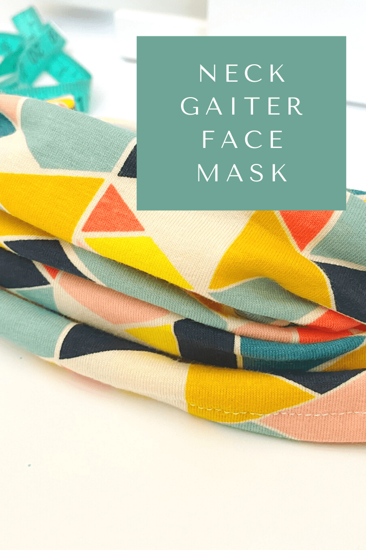 Neck gaiter face mask made from bright triangle print fabric.