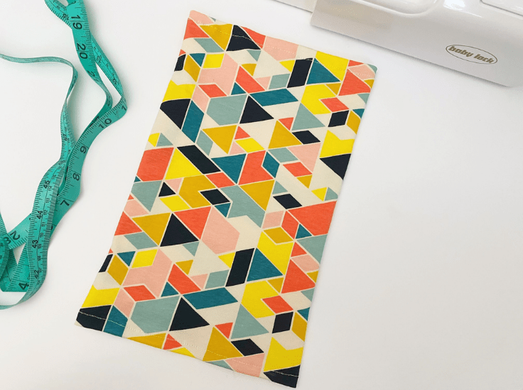 A bright colored fabric rectangle on a work table.