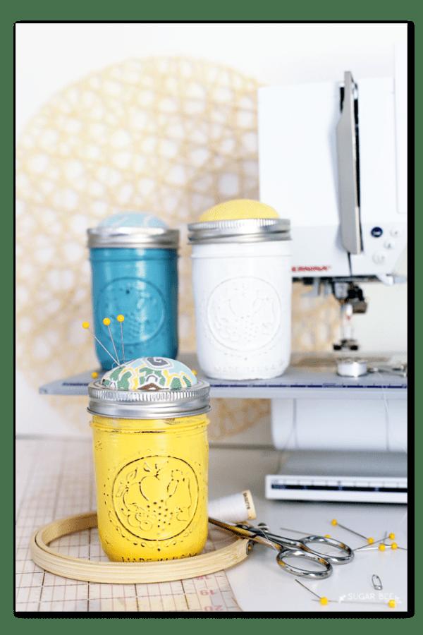 Yellow mason jar sewing kit with a pincushion lid.