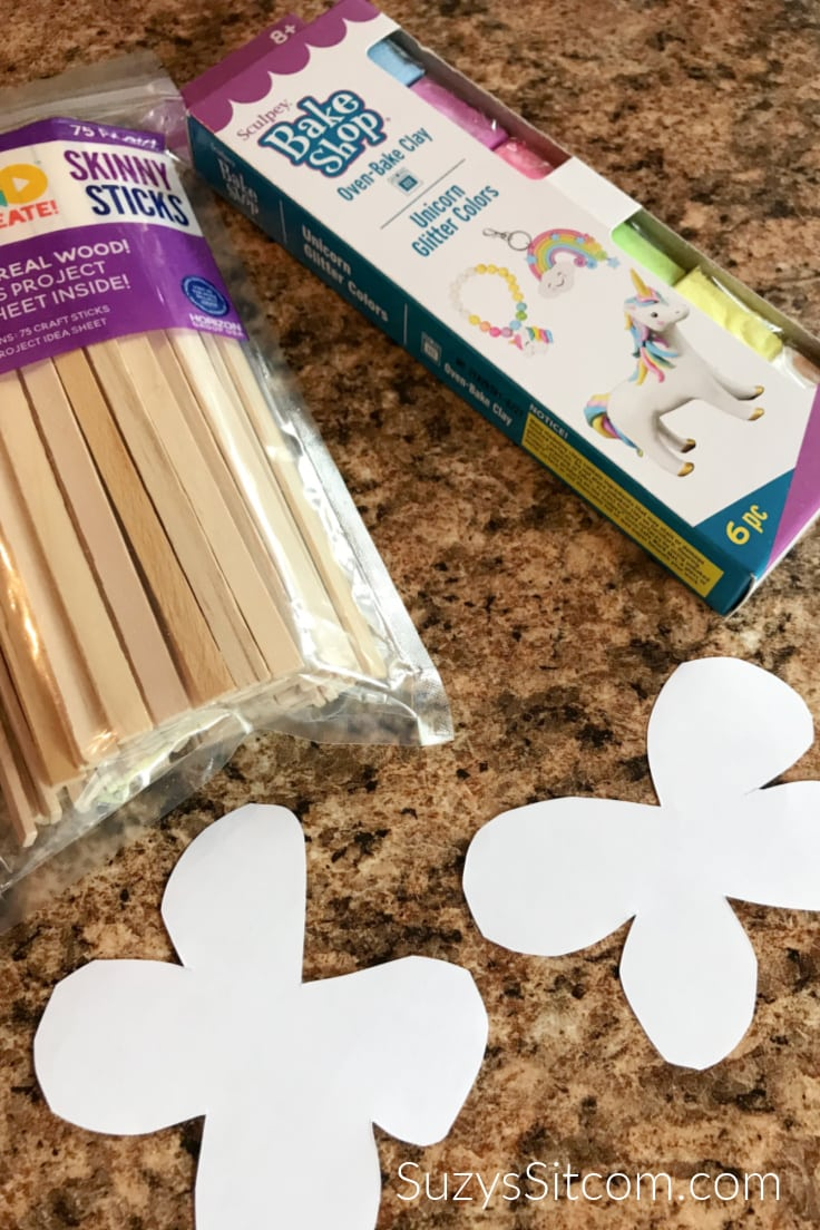 Wood craft ticks, oven-bake clay, and butterfly templates.
