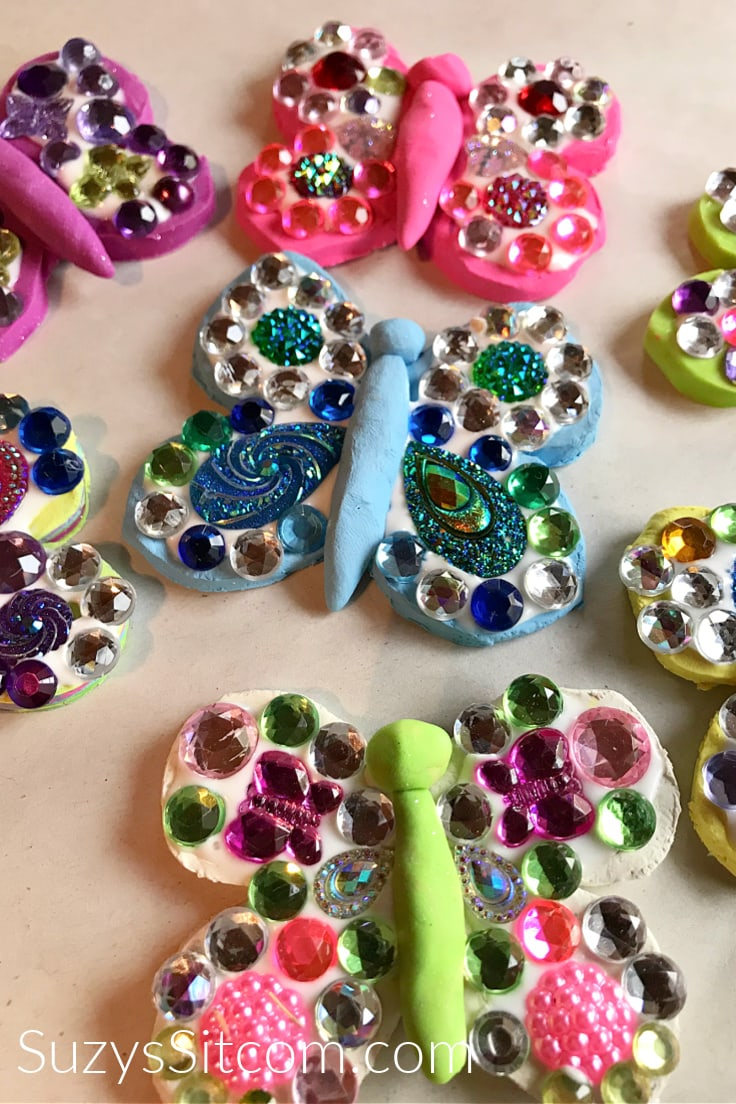 Clay butterflies covered in colorful matching gemstones.