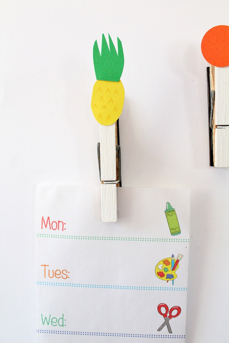 Pineapple clip holding a list of the days of the week.