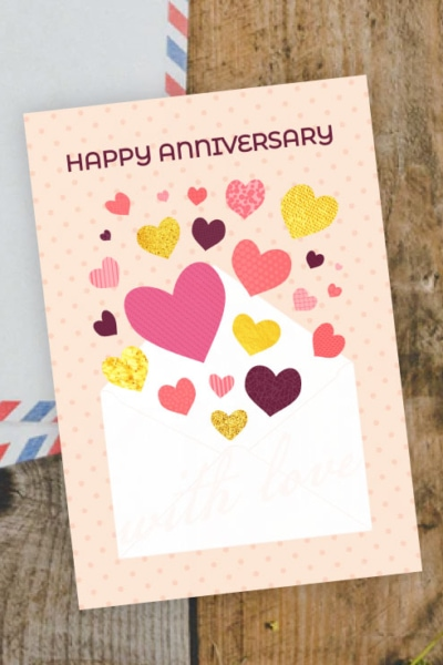 Preview of printable happy anniversary card with hearts coming out of envelope.