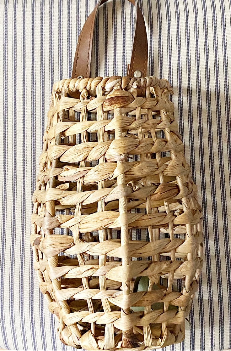 Empty rattan basket on striped background.