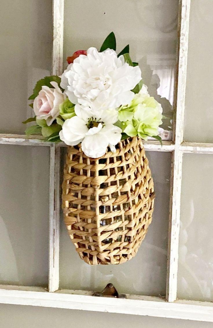 finished diy rattan floral basket on window