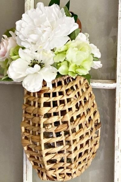 hanging floral rattan basket on window